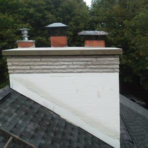 Chimney Limestone and new cement coating.